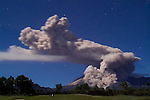 """Mount Merapi unleashes a 6-kilometer """"awan panas"""" eruption in the shape of a giant seated poodle at 1:30 a.m. on 11 June 2006. The hind legs of poodle mark an eruption streaming down Kali Gendol, aiming towards Kali Adem, the site of two deaths on 14 June. Many observers wonder why the alert status of the volcano was lowered on 13 June following recent large eruptions and in the face of continued threats that 6,000,000 cubic meters of fresh lava dome appeared ready to tumble from the summit."""