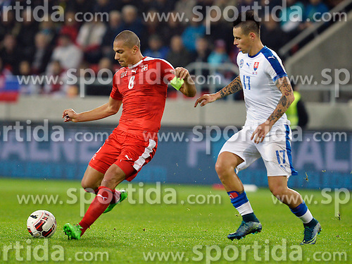 13.11.2015, Antona Malatinskeho Stadion, Trnava, SVK, Testspiel, Slowakei vs Schweiz, im Bild Gokhan Inler (Switzerland) and Marek Hamsik (Slovakia) // Gokhan Inler (Switzerland) and Marek Hamsik (Slovakia) during the International Football Friendly Match between Slovakia and Switzerland at the Antona Malatinskeho Stadion in Trnava, Slovakia on 2015/11/13. EXPA Pictures © 2015, PhotoCredit: EXPA/ Radovan Stoklasa
