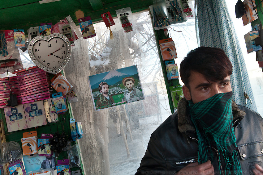 A mobile phone sellr and his shop. In the border town of Ishkashim, on the Tajikistan - Afghanistan border. Hindukush mountains.