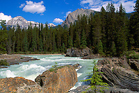 Yoho National Park, Canadian Rockies, BC, British Columbia, Canada - Kicking Horse River at the Natural Bridge, and Mt Stephen (Elev 3,199 m / 10,495 ft), Summer