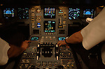 The flight-deck crew of a Sri Lankan Airlines A340-300 series Airbus - registration number 4R-ADE - perform a series of pre-flight checks before a scheduled departure, while on the apron at Malé international airport in the Republic of the Maldives. Featuring electronic instruments it is known as a 'glass cockpit' and using a printed checklist manual, they methodically work through dozens of complex systems that require accurate input before the aircraft is ready for take off. Flight navigation computers, fuel and engine settings and radio frequencies all need programming by the two pilots, the captain on the left and the First Officer on the right. These modern airliners have only two pilots in a modern flight-deck as technology superceeded the need for a third member, the flight-engineers of a previous era of aviation.