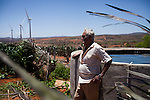 CAETITE, BRAZIL - OCTOBER 25, 2013:<br /> Florisvado Silva, 83, and his family agreed to be paid $250 a month to permit Renova Energia with wind turbines on their 46-acre land. A string of wind-turbine parks, in the municipal of Caetite, are being erected in the windiest stretches of Bahia state, Brazil, on Friday, Oct 25, 2013. <br /> (Photo by Lianne Milton/For The Washington Post