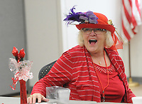 NWA Democrat-Gazette/FLIP PUTTHOFF <br /> THE COLOR OF FUN<br /> Shari Swanson laughs Wednesday Feb. 15 2017 with fellow Red Hat ladies during the Rogers Red Hat Hotties valentine party at the Rogers Adult Wellness Center. The group enjoyed a potluck lunch and camaraderie during their montly get together. The group meets once a month for lunch, games and trips around the region. The Red Hat Society is worldwide and open to women 50 and over with a mission of having fun and enjoying life.