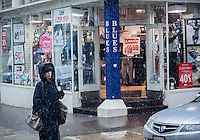 Passer-by in Chinatown in New York contend with even more snow on Saturday, January 25, 2014. The city has issued a snow alert and meteorologists predict only a dusting to an inch, with gusty winds,  this time around. (© Richard B. Levine)