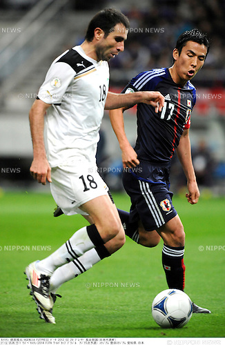 Timur Kapadze (UZB), Makoto Hasebe (JPN),.FEBRUARY 29, 2012 - Football / Soccer :.2014 FIFA World Cup Asian Qualifiers Third round Group C match between Japan 0-1 Uzbekistan at Toyota Stadium in Aichi, Japan. (Photo by Takamoto Tokuhara/AFLO)