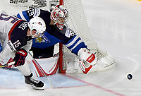 American Jack Eichel (L) attempts to score past Finish goalkeeper Harri Sateri during the Ice Hockey World Championship quarter-final match between the US and Finland in the Lanxess Arena in Cologne, Germany, 18 May 2017. Photo: Monika Skolimowska/dpa /MediaPunch ***FOR USA ONLY***