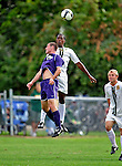 11 September 2009: University of Vermont Catamount forward/midfielder T.J. Gore (7), a Senior from Macomb, MI, heads the ball away from University of Portland Pilot midfielder Marc Tonkel, a Freshman from Los Gatos, CA, in the first round of the 2009 Morgan Stanley Smith Barney Soccer Classic held at Centennial Field in Burlington, Vermont. The Catamounts and Pilots battled to a 1-1 double-overtime tie. Mandatory Photo Credit: Ed Wolfstein Photo