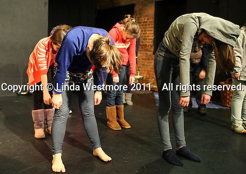 """Drama group for 8-13s rehearsing a production of """"Alice"""" in the Mill Studio at the Yvonne Arnaud Theatre, Guildford, Surrey."""