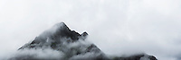 Mountain peak hidden in clouds, Lofoten Islands, Norway