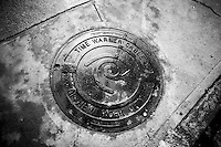 A Time Warner Cable labeled manhole in the Chelsea neighborhood of New York on Tuesday, February 3, 2015.   (© Richard B. Levine)