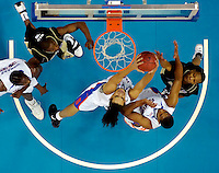 NEW ORLEANS, LA. 3/15/07-Florida's Joakim Noah grabs a rebound in traffic during first half action against Purdue, Sunday in the NCAA Tournament at the New Orleans Arena. COLIN HACKLEY PHOTO