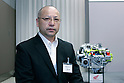TOKYO - SEPTEMBER 8, 2009: Atsushi Ogasawara (Honda R&amp;D)  poses among the company's new dual clutch transmission for use in large-displacement sport bikes during a press-conference at the company's Tokyo headquarter. A new VFR equipped with this transmission will be released in Europe and North America in 2010. (Photo Laurent Benchana/Nippon News)