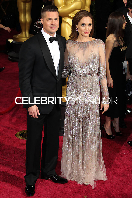 HOLLYWOOD, CA, USA - MARCH 02: Brad Pitt, Angelina Jolie at the 86th Annual Academy Awards held at Dolby Theatre on March 2, 2014 in Hollywood, Los Angeles, California, United States. (Photo by Xavier Collin/Celebrity Monitor)