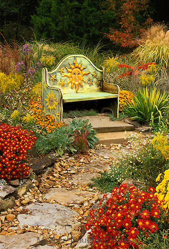 Mexican handmade bench in sun garden, midwest USA
