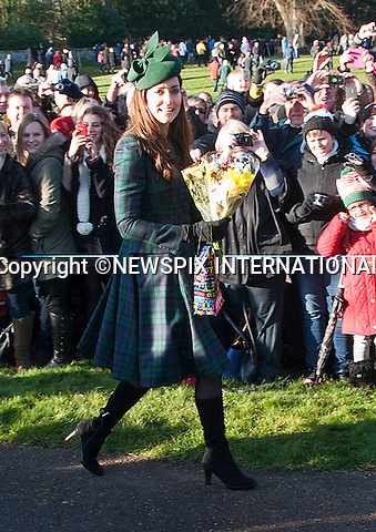 KATE, DUCHESS OF CAMBRIDGE<br /> joined other members of the Royal Family at the Christmas Day Church Service at St. Mary Magdalene's on the Sandringham Estate.<br /> Royals in attendance include the Queen, Prince Philip, Prince Charles, Camilla, Prince Andrew, Princesses Beatrice and Eugenie, Princes William and Harry, Princess Anne, Tim Laurence, Mike Tindall, Peter Phillips, Autumn Kelly, The Linleys and The Chattos_25/12/2013<br /> MANDATORY PHOTO CREDIT: &copy;NEWSPIX INTERNATIONAL<br /> <br /> (Failure to credit will incur a surcharge of 100% of reproduction fees)<br /> <br /> **ALL FEES PAYABLE TO: &quot;NEWSPIX  INTERNATIONAL&quot;**<br /> <br /> Newspix International, 31 Chinnery Hill, Bishop's Stortford, ENGLAND CM23 3PS<br /> Tel:+441279 324672<br /> Fax: +441279656877<br /> Mobile:  07775681153<br /> e-mail: info@newspixinternational.co.uk