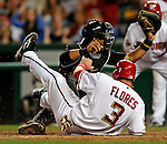 16 August 2008: Colorado Rockies' catcher Yorvit Torrealba gets Washington Nationals' catcher Jesus Flores out at home in the bottom of the sixth inning at Nationals Park in Washington, DC.  The Rockies defeated the Nationals 13-6, handing the last place Nationals their 9th consecutive loss. ..Mandatory Photo Credit: Ed Wolfstein Photo