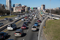 View of I-35 Interstate Highway traffic congestion on Sunday afternoon at 2pm in downtown Austin, Texas.