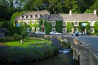 Swan Hotel and River Coln at Bibury in The Cotswolds UK. L to R: Audi A8, Mercedes C Class (2 silver cars), BMW 7 Series