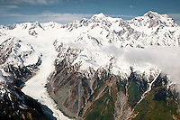 Aerial views of Fox Glacier and its valley with Mt. Tasman 3497m on left and Mt. Cook 3754m right dominating skyline, Westland National Park, West Coast, New Zealand