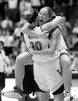 University of Virginia seniors Lisa Hosac and Lauren Swierczek celebrate the Cavaliers' ACC Women's Basketball title after defeating Wake Forest in the final regular season game of 2000.