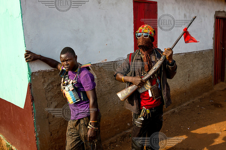 Anti-Balaka fighters wearing Gris-Gris (Anti-Machete) charms. One man carries a homemade gun. In 2013 a rebellion by a predominantly Muslim rebel group Seleka, led by Michel Djotodia, toppled the government of President Francios Bozize. Djotodia declared that Seleka would be disbanded but as law and order collapsed the ex-Seleka fighters roamed the country committing atrocities against the civilian population. In response a vigillante group, calling themselves Anti-Balaka, sought to defend their lives and property but they then began to take reprisals against the Muslim population and the conflict became increasingly sectarian. French and Chadian peacekeeping forces have struggled to contain the situation and the smaller Muslim population began to flee the country.