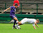 13 September 2009: University of Portland Pilots' defenseman Drew Chrostek (2), a Senior from Corvallis, OR, controls the ball as University of New Hampshire Wildcats' midfielder Brad Hilton, a Sophomore from Merrimack, NH, takes a tumble during the second round of the 2009 Morgan Stanley Smith Barney Soccer Classic held at Centennial Field in Burlington, Vermont. The Pilots defeated the Wildcats 1-0 and inso doing were the Tournament Champions for 2009. Mandatory Photo Credit: Ed Wolfstein Photo