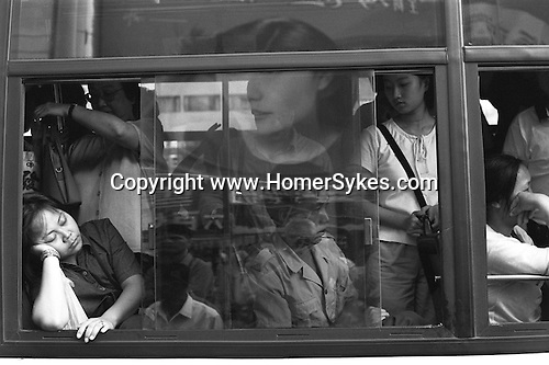 The bus home to the suburbs. Shanghai. The Peoples Republic of China. 2000.