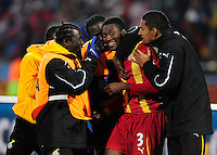 Asamoah Gyan of Ghana celebrates at the final whistle with team mates. Ghana defeated the USA 2-1 in overtime in the 2010 FIFA World Cup at Royal Bafokeng Stadium in Rustenburg, South Africa on June 26, 2010.