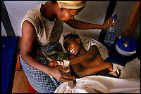 Luanda, Angola, May 20, 2006.Juana, 7, is a patient at the Cacuaco MSF Belgium operated cholera field clinic. Between February and June 2006, more than 30000 people were infected with cholera in Angola's worse outbreak ever; more than 1300 died..Just 4 years after the end of a 25 year long civil war, Angola is starting to emerge again, yet a lot remains to be done: entire regions are still cut-off from the ouside world because of landmines and broken bridges, over 80% of the population lives below the poverty threshold in one of the potentially richest country in Africa. Natural ressources include oil, diamonds, gold and...water!.Malaria, tuberculosis, HIV/Aids are endemic, cholera and meningitis frequent.