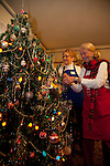 Volunteers decorate a Christmas Tree at the J. Gilbert Smith House in Los Altos in preparation for a Holiday Open House Nov. 4.