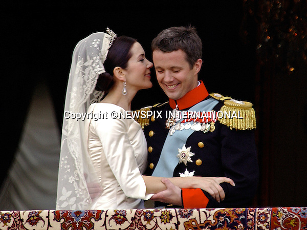 "WEDDING ROYAL KISSES_CROWN PRINCE FREDERIK & MARY DONALDSON.a lot can read into a public kiss and body language..Crown Prince Frederik and Mary Donaldson on the balcony of Amalienborg Palace on their wedding day, London_14/05/2004.Mandatory Photo Credit: ©Francis Dias/Newspix International..**ALL FEES PAYABLE  TO: ""NEWSPIX INTERNATIONAL""**..PHOTO CREDIT MANDATORY!!: NEWSPIX INTERNATIONAL(Failure to credit will incur a surcharge of 100% of reproduction fees)..IMMEDIATE CONFIRMATION OF USAGE REQUIRED:.Newspix International, 31 Chinnery Hill, Bishop's Stortford, ENGLAND CM23 3PS.Tel:+441279 324672  ; Fax: +441279656877.Mobile:  0777568 1153.e-mail: info@newspixinternational.co.uk"