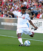 Toronto defender Danleigh Borman (25) sends in a cross.  The Chicago Fire defeated Toronto FC 2-0 at Toyota Park in Bridgeview, IL on August 21, 2011.