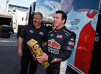 Mar 18, 2017; Gainesville , FL, USA; Crew member for NHRA top fuel driver Leah Pritchett talks with Papa Johns Pizza founder John Schnatter during qualifying for the Gatornationals at Gainesville Raceway. Mandatory Credit: Mark J. Rebilas-USA TODAY Sports