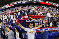 New York Red Bulls fans during the playing of the national anthem prior to playing the Columbus Crew. The New York Red Bulls and the Columbus Crew played to a 2-2 tie during a Major League Soccer (MLS) match at Red Bull Arena in Harrison, NJ, on May 26, 2013.