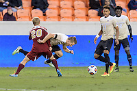 Houston, TX - Friday December 9, 2016: Chandler Crosswait (20) of the Denver Pioneers trips a Wake Forest Demon Deacons player in the first half  at the  NCAA Men's Soccer Semifinals at BBVA Compass Stadium.
