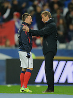 Jurgen Klinsmann (right), coach of team USA, hugs his former player Franck Ribery of France prior to the friendly match France against USA at the Stade de France in Paris, France on November 11th, 2011.