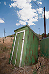 Green metal outhouse