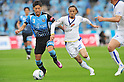 Yusuke Tanaka (Frontale), Kunimitsu Sekiguchi (Vegalta), APRIL 23rd, 2011 - Football : 2011 J.League Division 1 match between Kawasaki Frontale 1-2 Vegalta Sendai at Todoroki Stadium in Kanagawa, Japan. (Photo by AFLO).