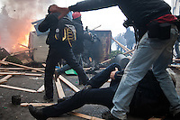 A camera operator had his leg broken by a stray cobblestone.<br /> <br /> Riots in Rome after Senate and Lower House vote of confidence that resulted in a razor-thin victory for Berlusconi to continue his mandate.  Dec. 14, 2010 (Photo by Riccardo Budini / UnFrame)