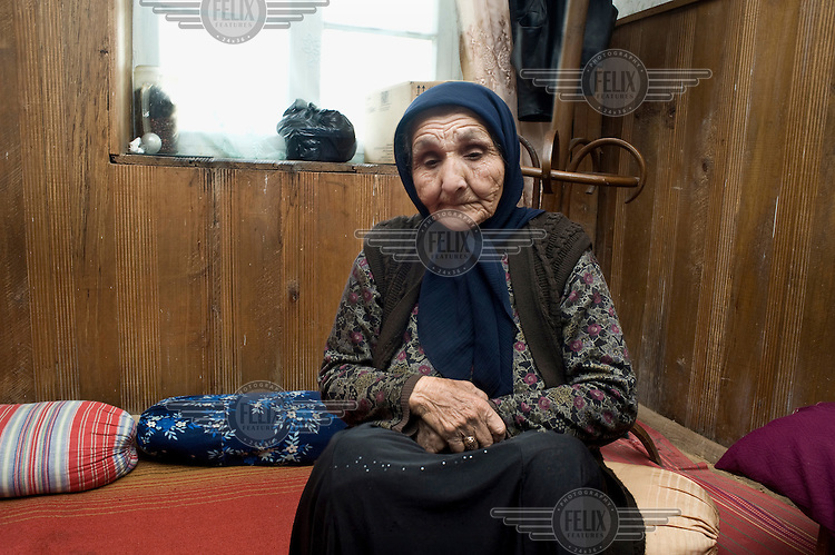 An elderly ethnic Chechen woman waiting for Friday prayers.