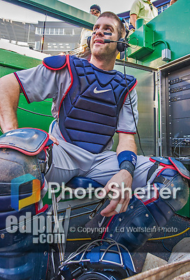 8 June 2013: Minnesota Twins catcher Joe Mauer is interviewed in the dugout after a game against the Washington Nationals at Nationals Park in Washington, DC. The Twins edged out the Nationals 4-3 in 11 innings. Mandatory Credit: Ed Wolfstein Photo *** RAW (NEF) Image File Available ***