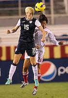 BOCA RATON, FL - DECEMBER 15, 2012: Megan Rapinoe (15) of the USA WNT heads away from Wu Haiyan (26) of China WNT during an international friendly match at FAU Stadium, in Boca Raton, Florida, on Saturday, December 15, 2012. USA won 4-1.