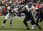Seattle Seahawks defensive tackle D'Anthony Smith (right, closes in on Denver Broncos running back Montee Ball during the third quarter at CenturyLink Field on August 14, 2015 in Seattle Washington.  The Broncos beat the Seahawks 22-20.  © 2015. Jim Bryant Photo. All Rights Reserved.