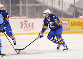 Buffalo Junior Sabres defensemen Jason Heerdt (28) during a game against the St. Michaels Buzzers at the Frozen Frontier outdoor game at Frontier Field on December 15, 2013 in Rochester, New York.  St. Michael's defeated Buffalo 5-4.  (Copyright Mike Janes Photography)