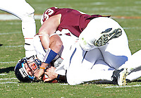 Nov 27, 2010; Charlottesville, VA, USA; Virginia Cavaliers quarterback Marc Verica (6) is tackled by Virginia Tech Hokies defensive end Chris Drager (33) during the game at Lane Stadium. Virginia Tech won 37-7. Mandatory Credit: Andrew Shurtleff