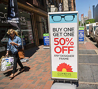 "Cohen's Fashion Opticals offers a ""buy one, get one 50% off"" promotion in New York, seen on Friday, May 20, 2016.  (© Richard B. Levine)"