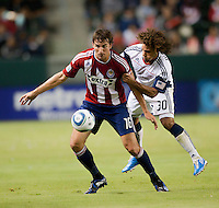 Chivas forward Alan Gordon (16) shields Revolution defender Kevin Alston (30) from the ball during the first half of the game between Chivas USA and the New England Revolution at the Home Depot Center in Carson, CA, on September 10, 2010. Chivas USA 2, New England Revolution 0.