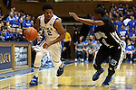 04 November 2014: Duke's Quinn Cook (2) and Livingstone's Juwan Cole (1). The Duke University Blue Devils hosted the Livingstone College Blue Bears at Cameron Indoor Stadium in Durham, North Carolina in an NCAA Men's Basketball exhibition game.