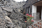 Aa lava flow from Fogo Volcano burying a building in Portela, Cape Verde