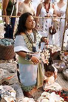 Maya woman selling sea shell jewelry at the recreation of an ancient Mayan market, Sacred Mayan Journey 2011 event, Riviera Maya, Quintana Roo, Mexico